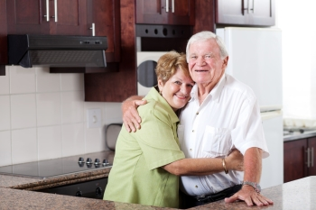 Older couple living in affordable Texas senior apartment.